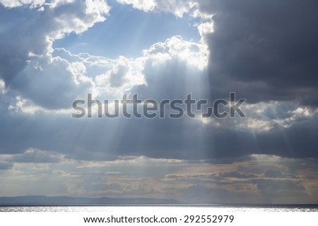 Sky with clouds and sun,Dark clouds before thunderstorm - stock photo