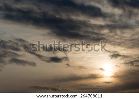sky with clouds at dawn sun - stock photo