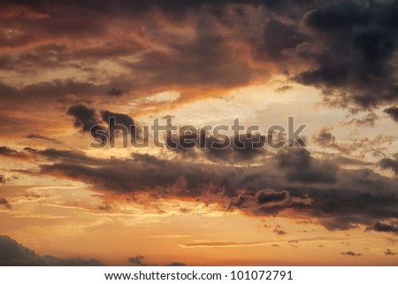sky with clouds at sunset during storm - stock photo