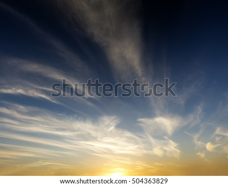 sky with clouds at sunset.Fiery orange sunset sky.relaxing summer heavenly landscape at sunset.