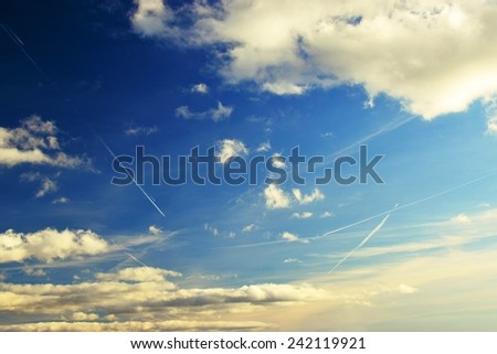 Sky with clouds. Beautiful blue natural background. Traces of the aircraft - chemtrails - stock photo