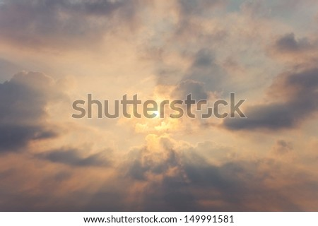 Sky with cumulus clouds and a bright sun - stock photo