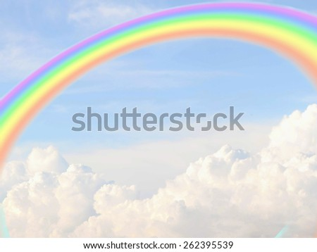 sky with cumulus clouds and beautiful rainbow - stock photo