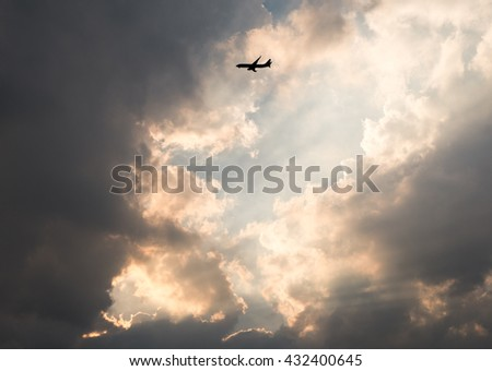 Sky with dark clouds and sun rays - Plane with sky - Red sunset, rich dark clouds, rays of light - stock photo