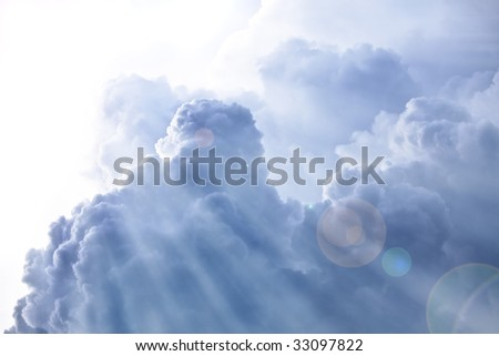 Sky with fluffy clouds and sun rays. Ideal for background. - stock photo