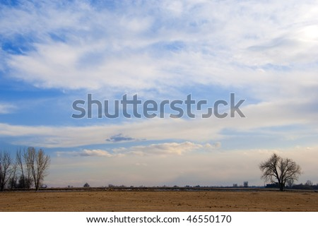 Sky with gentle pastel colors in late afternoon over a low horizon peaceful and simple scene on the Colorado prairie - stock photo