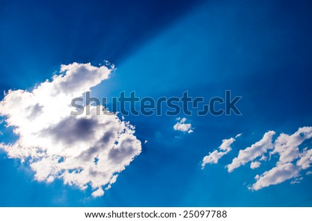 Sky with sunbeams for background - stock photo
