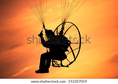 Skydiver against sunset