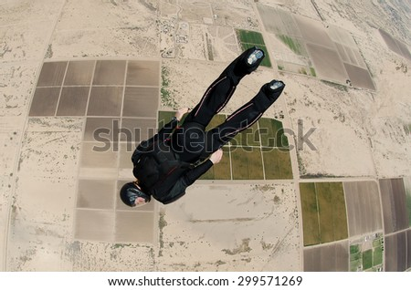 Skydiver diving to the earth - stock photo