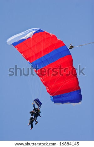 skydiver floating to the ground - stock photo