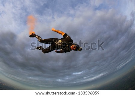 Skydiver free-fall at sunset - stock photo