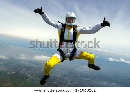 Skydiver in free style. - stock photo