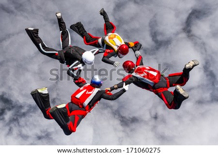 Skydivers in relative work. - stock photo