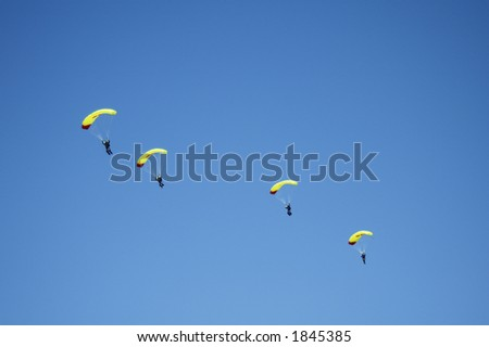Skydivers participating in an international team competition.