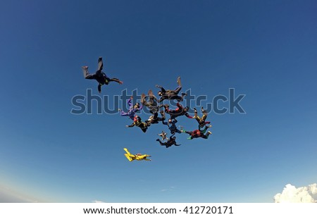 Skydivers trying to make a formation in free fall - stock photo