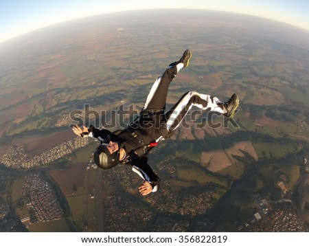 Skydiving back fly man - stock photo