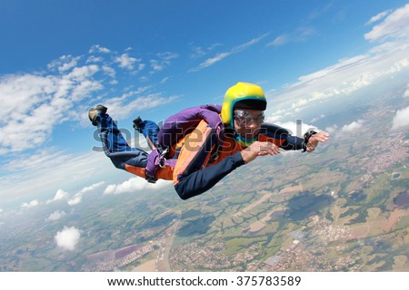 Skydiving courageous middle-aged man - stock photo