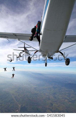 Skydiving exit - stock photo