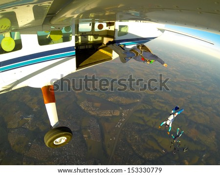 skydiving exit point of view - stock photo