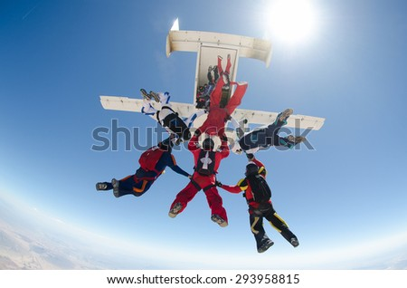 Skydiving Group exit - stock photo