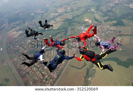 Skydiving group formation men and women - stock photo