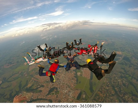 Skydiving group of friends team work - stock photo