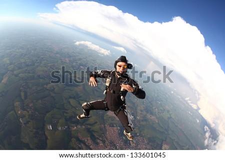 Skydiving man at free-fall - stock photo