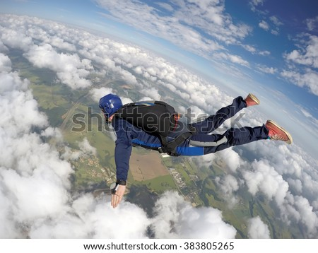 Skydiving starting a diving motion - stock photo
