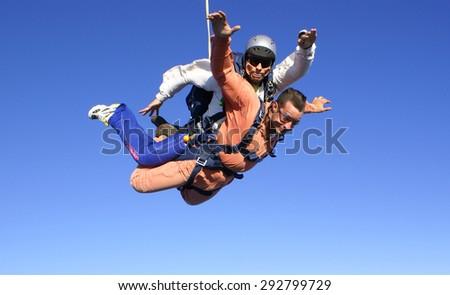 Skydiving tandem fall season - stock photo