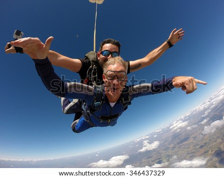 Skydiving tandem happiness middle aged man - stock photo