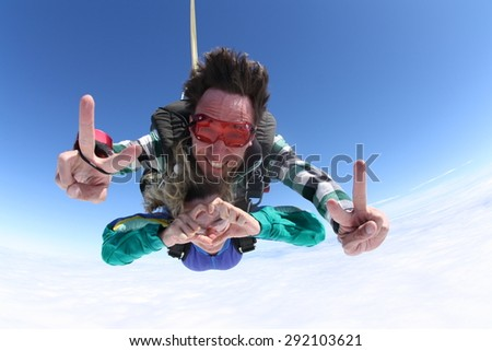 Skydiving Tandem peace love and heart signs - stock photo