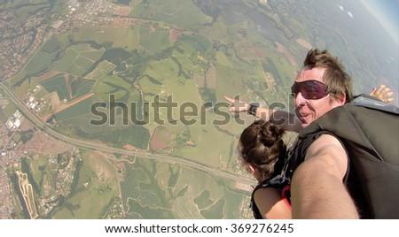 Skydiving tandem self portrait - stock photo
