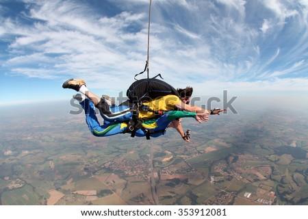 Skydiving tandem soft focus - stock photo