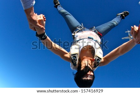 skydiving woman in head down position - stock photo
