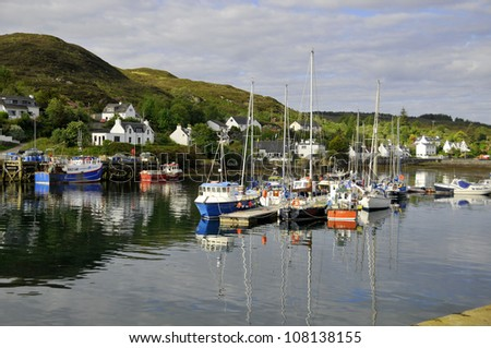 SKYE ISLAND SCOTLAND UK JUNE 8: Boats in the harbor of Kyleakin on June 8 2012 in Skye Island, Scotland, UK. The village of Kyleakin is also the site of Castle Moil, an ancient ruined fortress.