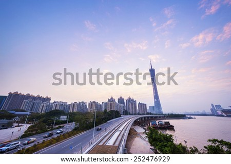 skyline and cityscape of modern city guangzhou during sunset at riverside - stock photo