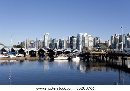 Skyline and Coal Harbour Marina in Vancouver, Canada - stock photo