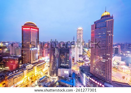 skyline and office buildings of modern city nanjing at night. - stock photo