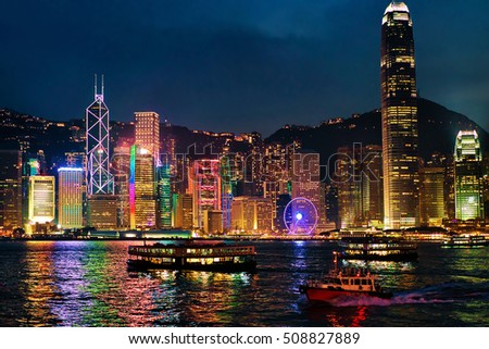 Skyline at Victoria Harbor, Hong Kong. View from Kowloon on HK Island. In the evening