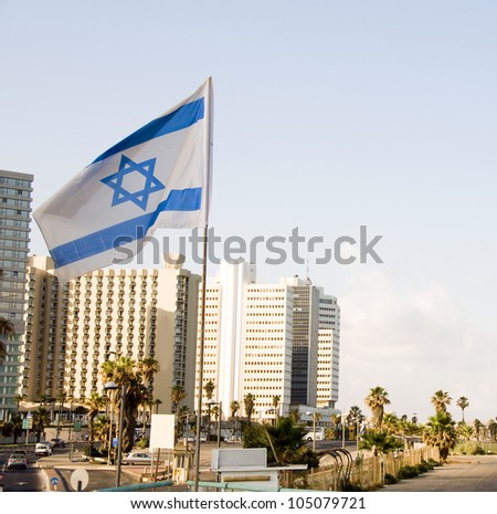 skyline cityscape with national Israeli flag and high rise hotel buildingsTel Aviv Israel - stock photo