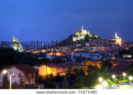 Skyline Le Puy-en-Velay in central France at twilight time - stock photo