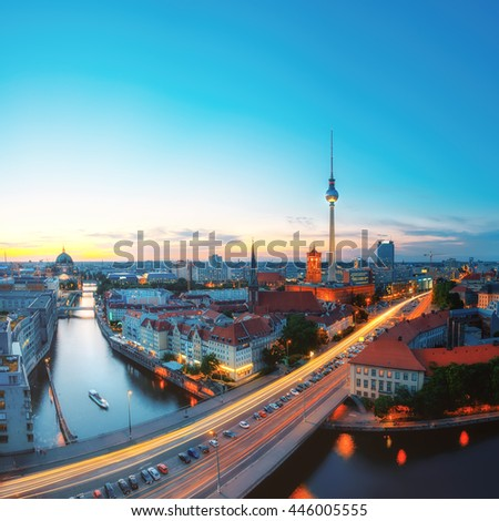 Skyline Of Berlin in Germany with TV Tower, Berlin Town Hall and a busy street in the evening - stock photo