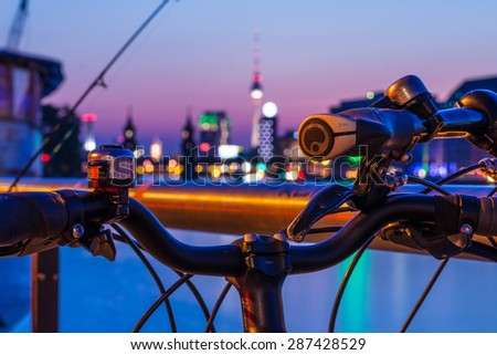 Skyline of Berlin . The Oberbaum Bridge and River Spree in Berlin. In front handlebar with bell and circuit . - stock photo