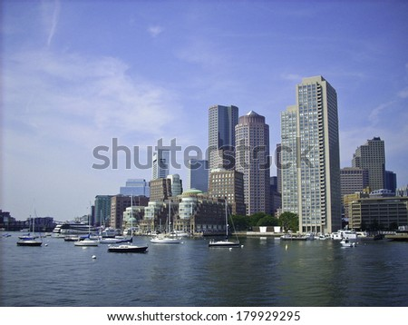 Skyline of Boston Harbor coming in from a ferry - stock photo