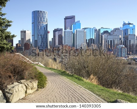 Skyline of Calgary, Alberta, Canada. Leaves on trees just starting to bud.  - stock photo