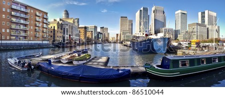 Skyline of Canary Wharf view from West India Millwall Docks. This view includes: Citigroup Centre,Morgan Stanley and Luxury Riverside Apartments. - stock photo