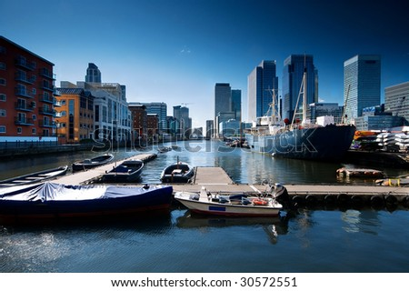 Skyline of Canary Wharf view from West India Millwall Docks. This view including: Citigroup Centre,Morgan Stanley, HSBC Tower and Luxury Riverside Apartments. - stock photo