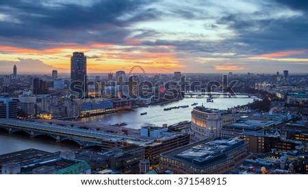 Skyline of central London with famous landmarks, River Thames, skyscrapers and Blackfriars Bridge at sunset - London, UK - stock photo
