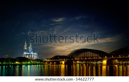 skyline of Cologne (germany) at night featuring the famous Cologne Cathedral - stock photo
