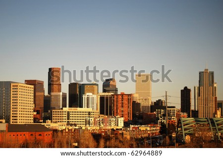 Skyline of Denver skycrapers. Big blue cloudless sky.